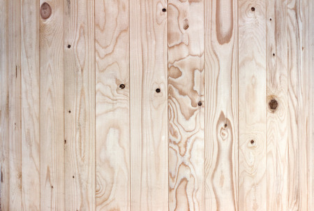 close p: Close up of a light wooden wall of vertical boards with intensive grain Stock Photo