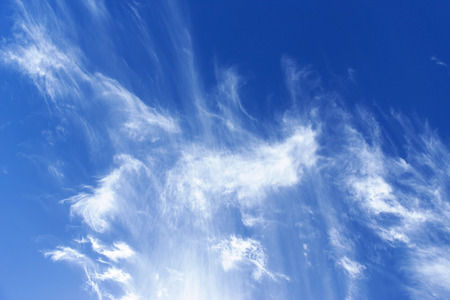 cirrus: Close-up of white cirrus clouds in the dark blue sky, taken in the Canary Islands in Spain. Stock Photo