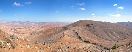 fv: Fuerteventura - view from the Morro de la Cruz over the pass road of Betancuria and the Mirador de Morro Velosa to the east coast of the island. On the left the village of Valle de Santa Ines.