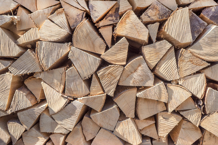 Detail shot of a woodpile with fire wood with ribbed intersections