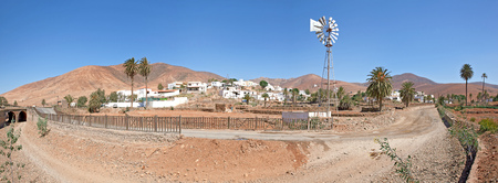 The village Toto in Fuerteventura, Canary Islands, Spain - taken from the south. In the background the southern edge of the Massif Central. photo