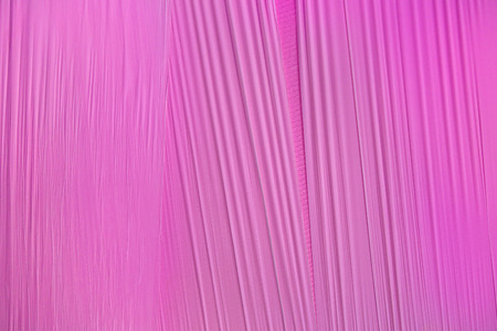 taut: Pattern of a pink foil with taut, slightly corrugated surface Stock Photo