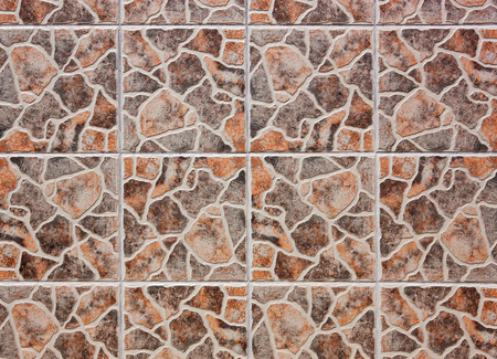 rotations: Pattern of beige-brown mosaic tiles. The always same tile was installed with various rotations.
