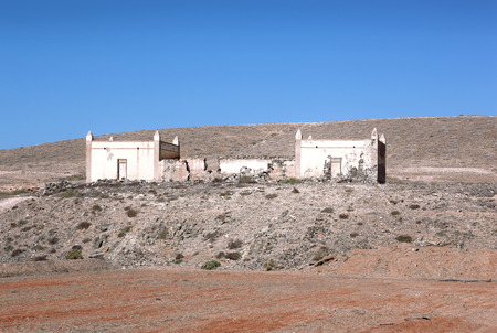 single story: Ruin of a one-storied house with interesting pointed pillars near Ajui in Fuerteventura, Canary Islands, Spain.