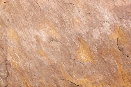 Detail of the abstract pattern of an ocher stone slab with a slight relief Stock Photo
