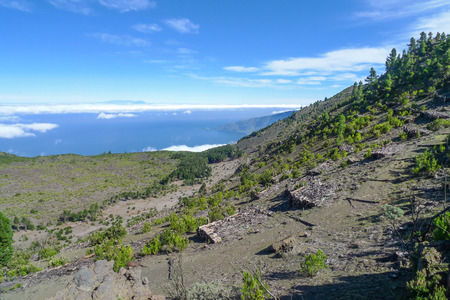 neighboring: Mountain landscape in the west of El Hierro above the El Golfo valley. On the horizon the neighboring island of La Palma.