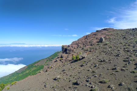 neighboring: Mountainside in the west of El Hierro with a view to the neighboring island of La Palma, taken from the pilgrims way Camino de la Virgen. Stock Photo