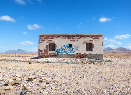 sprayed: Abandoned, sprayed with graffiti house in Fuerteventura, taken next to the dam Embalse de Los Molinos in the west of island.
