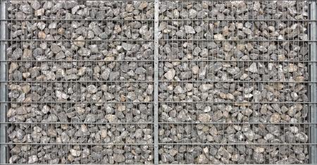 gabion: Large symmetric gabion filled with medium-sized, grau natural stones