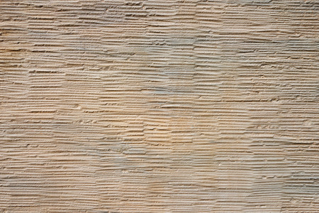 roughcast: Detail shot of beige-gray plaster with an abstract pattern of horizontal texture Stock Photo