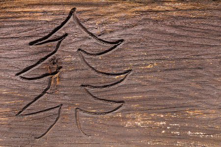 christmas motif: Carved motif of a fir tree in a weathered brown wood