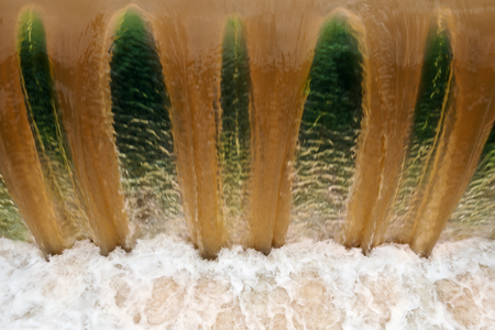 Detail shot of falling, dirty brown water at an overflowed weir after heavy rain Фото со стока - 39646946