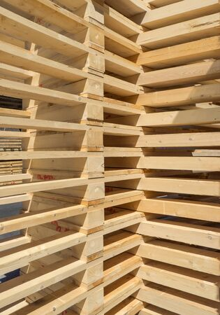tidy: Closeup of new tidy one above the other stacked wooden pallets Stock Photo