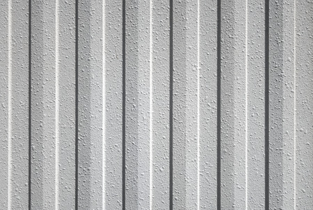 wall covering: Gray textured plastic cladding