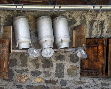 mountain hut: Milk churns at a mountain hut