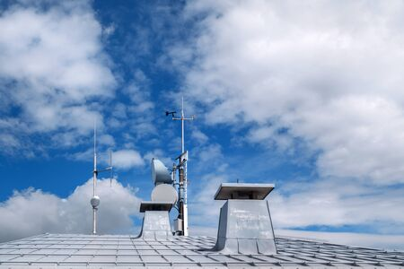 strut: Metal roof with chimneys and antennas