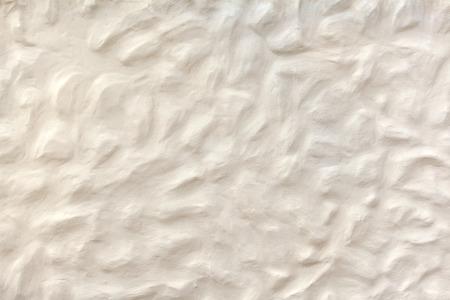 plasterwork: White beige plasterwork with bumpy surface Stock Photo