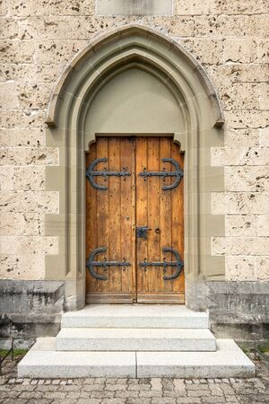mountings: Brown churchdoor with gothic stepped portal