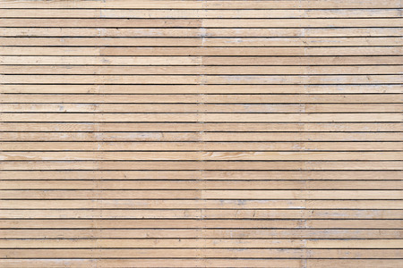stripe background: Bright wooden facade with horizontal battens