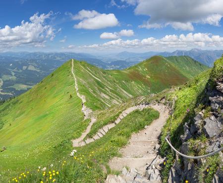 Ridge trail in the green summery Alps from Fellhorn to Soellereck