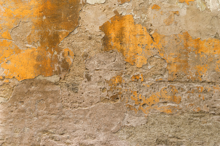 Crumbled yellow brown plaster