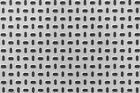 Gray metal plate with dark punched pattern Stock Photo