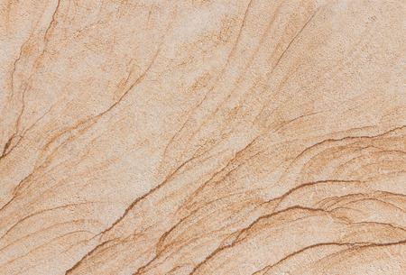 brownstone: Abstract texture of a beige and brownstone slab