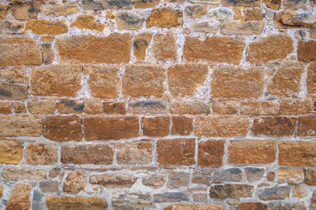 nuances: Old stonewall with bluish nuances brown Stock Photo
