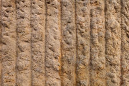 vertical lines: La textura de la piedra de la arena con las l�neas verticales Foto de archivo