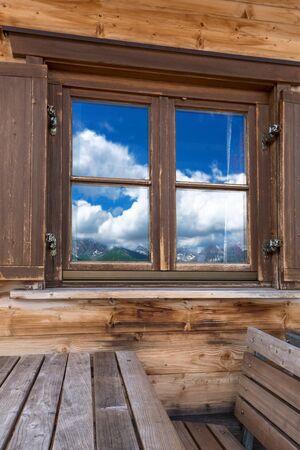 windowpane: Mountains reflecting in the window Stock Photo