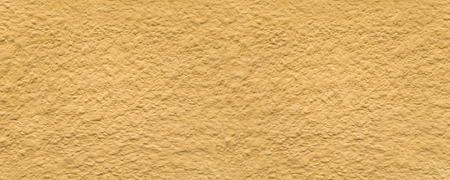 plasterwork: Panorama of a yellow house wall with rough plaster Stock Photo