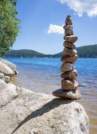 balanced rocks: Rock balancing at a lake Stock Photo