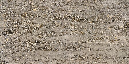 exposed: Coarse made, gray concrete wall with partially exposed pebbles Stock Photo