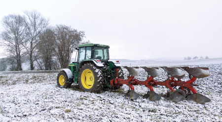 Tractor with plow in winter