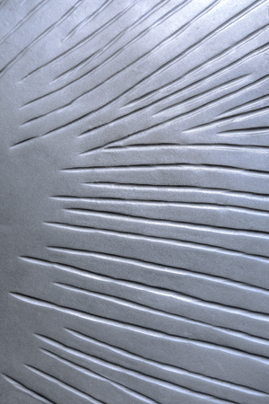 Abstract pattern of a silver metal plate with grooves