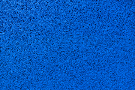 Blue wall texture made of granular rough plaster