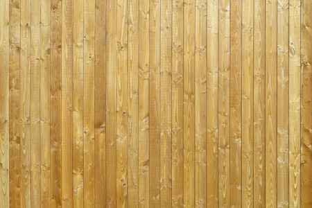 Wooden wall made of vertical boards