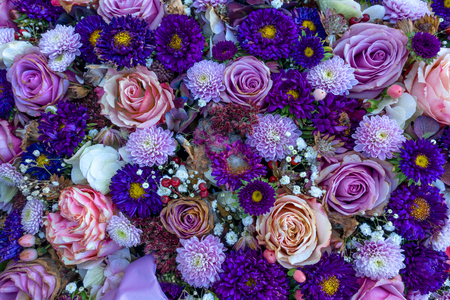 Slightly withered purple flower arrangement