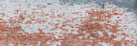 Panorama of a very old and crooked brick wall Stock Photo