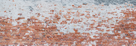 Panorama of a very crooked, old brick wall
