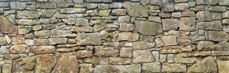 Very old, rough natural stone wall Stock Photo