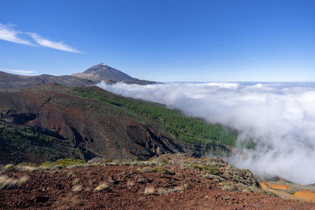 Ascending clouds in the national park of Tenerife with Teide Stock Photo