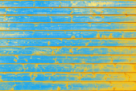Weathered, blue orange board wall Banque d'images