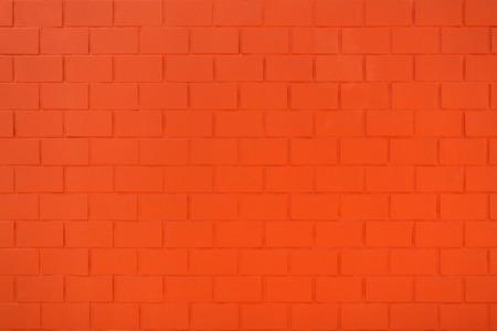 Orange red painted brick wall
