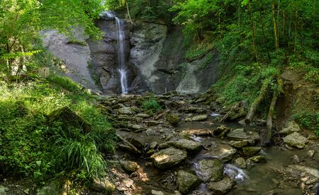 Waterfall of Zillhausen - Panorama with stony creek bed in summer near Balingen in the Swabian Alb, Germany
