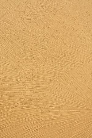 Detail of a yellow wall texture made of rough plaster Stockfoto