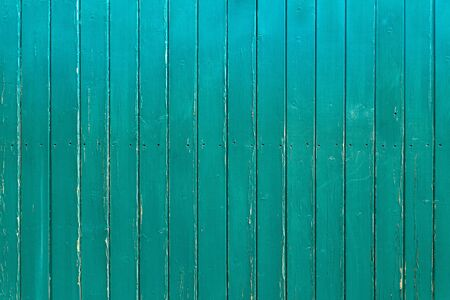 Slightly weathered, turquoise wooden wall