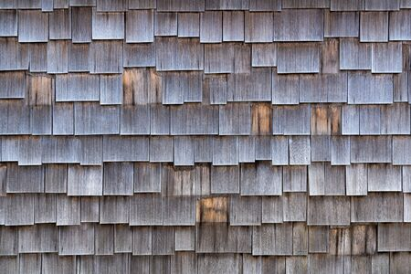 Wall covering made of old, partly missing wooden shingles