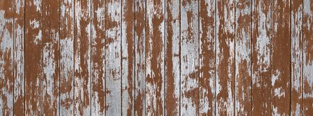 Old brown weathered wood cladding