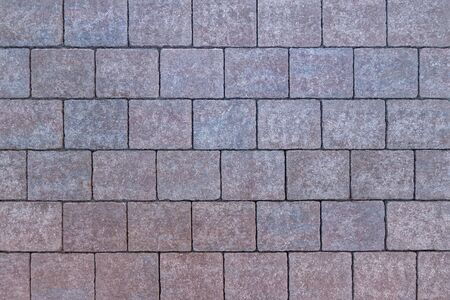 Pattern of square, reddish and bluish paving stones Stockfoto
